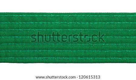 Karate green belt closeup isolated on white background - stock photo