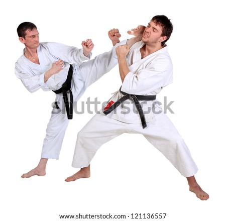 Karate. Men in a kimono with a white background. Battle sports capture - stock photo