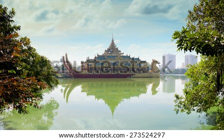 Karaweik, a concrete replica of a Burmese royal barge on Kandawgyi Lake in Yangon, Myanmar. Currently houses a buffet restaurant. - stock photo