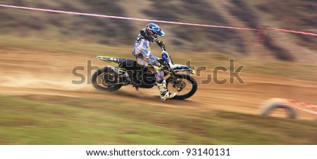 """KARGALY, KAZAKHSTAN - APRIL 10: A.Tindikov(7) in action at Motocross competition """"Fabrichny Cup""""- Open Championship of Kazakhstan, on April 10, 2011 in Kargaly, Kazakhstan. - stock photo"""