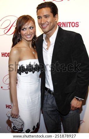 Karina Smirnoff and Mario Lopez arrive to the opening of Beso Restaurant held at the Beso in Hollywood, California, United States on March 6, 2008. - stock photo