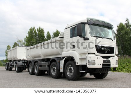 KARJAA, FINLAND - JULY 7: MAN TGS 35.480 heavy duty truck parked in Karjaa, Finland on July 7. MAN heavy duty trucks use SCR technology to meet the Euro 5 and the more stringent EEV standard. - stock photo