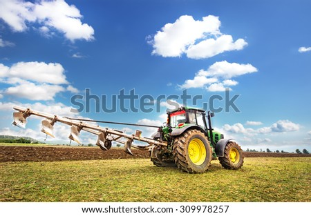 Karlovo, Bulgaria - August 22th, 2015:  Ploughing a field with John Deere 6930 tractor. John Deere 8100 was manufactured in 1995-1999 and it has JD 7.6L or 8.1L 6-cyl diesel engine. - stock photo