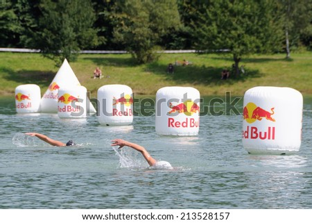 KAROLINKA, CZECH REPUBLIC - AUGUST 08, 2014: Racers swims at the Valachia Man triathlon - stock photo