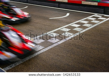 Kart crossing the finish line - stock photo