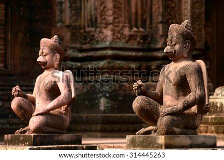 Karuda Bird Gardians Carvings at Banteay Srei Red Sandstone Temple, Cambodia - stock photo