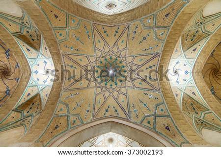 Kashan, Iran - December 8, 2015: Beautiful ceiling of Agha Bozorg Mosque in Kashan, Iran - stock photo