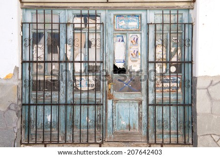 KASSANDRINO,GREECE-JULY 18 2014:A closed down shop in a small Greek village.Many stores have closed due to the economic state of the Euro zone - stock photo