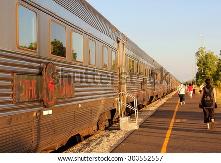 KATHERINE,NORTHERN TERRITORY,AUSTRALIA - March 20. Passengers depart with The Ghan train to Alice Springs on March 20, 2013 in Katherine.The Ghan drives from  Darwin to Adelaide, 3200 km train journey - stock photo