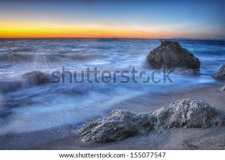 Kathisma beach, Lefkada, Greece surprised at twilight. - stock photo