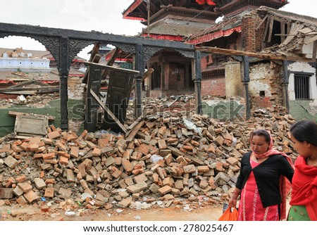 KATHMANDU - APRIL 27: Nepalese women walk after earthquake, near Durbar square, end of April 2015, Kathmandu, Nepal - stock photo