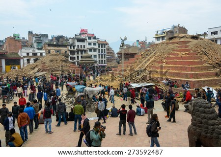 KATHMANDU, NEPAL - APRIL 26, 2015: Durbar Square, a UNESCO World Heritage Site, is severly damaged after the major earthquake on 25 April 2015. - stock photo