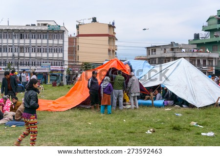 KATHMANDU, NEPAL - APRIL 25, 2015: People gather on an open ground at Chuchepati just after the 7.8 earthquake hit Kathmandu - stock photo