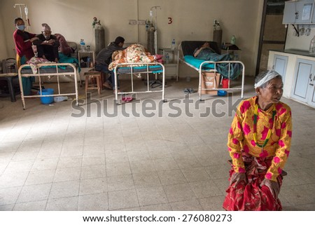 KATHMANDU, NEPAL - APRIL 30, 2015: People wait for treatment at Pakhtapur Hospital in Kathmandu, Nepal suffered a magnitude 7.8 earthquake killing over 7,000 people and injuring thousands more. - stock photo