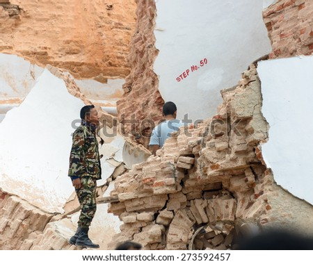 KATHMANDU, NEPAL - APRIL 26, 2015: Rescue effort at the collapsed Dharhara tower after the major earthquake on 25 April 2015. - stock photo