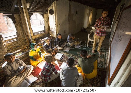 KATHMANDU, NEPAL - DEC 9, 2013: Unknown children in lesson at Jagadguru School. School established at 2013, to let new generation learn Sanskrit and preserve Hindu culture. - stock photo