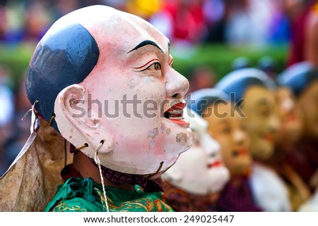 KATHMANDU, NEPAL - MARCH 25: Buddhist monks during Cham mystery at Shechen monastery on March 25, 2010 in Kathmandu, Nepal. Cham are considered a form of meditation and an offering to the gods. - stock photo