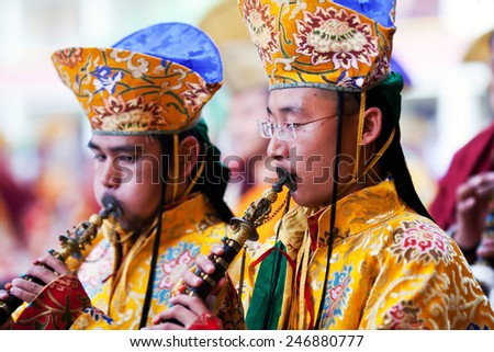 KATHMANDU, NEPAL - MARCH 25: Buddhist monks playing music during Cham mystery at Shechen monastery on March 25, 2010 in Kathmandu, Nepal. Cham is a form of meditation and an offering to the gods. - stock photo