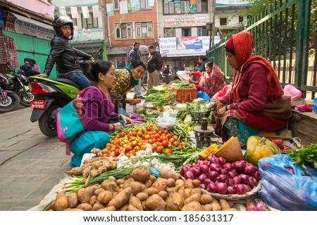 KATHMANDU, NEPAL - NOV 28, 2013: Unidentified street vendor in historic center of city. Largest city of Nepal, its economic center, a population of over 1 million people. - stock photo