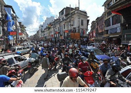 KATHMANDU - OCT 9: Traffic jam and air pollution in central Kathmandu on October 9, 2012 in Kathmandu, Nepal.Kathmandu valley is expected to pass 2 million vehicles on its roads by the end of the year - stock photo