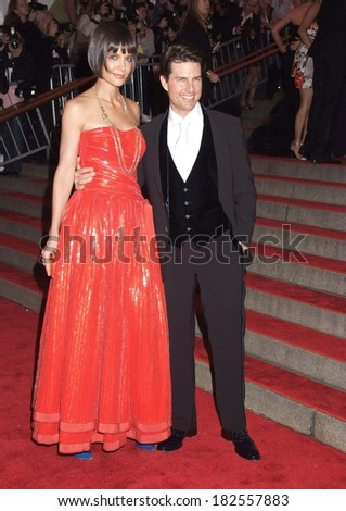 Katie Holmes, wearing an Armani gown,, Tom Cruise at Superheroes Fashion and Fantasy Gala, Metropolitan Museum of Art Costume Institute, New York, NY, May 05, 2008 - stock photo