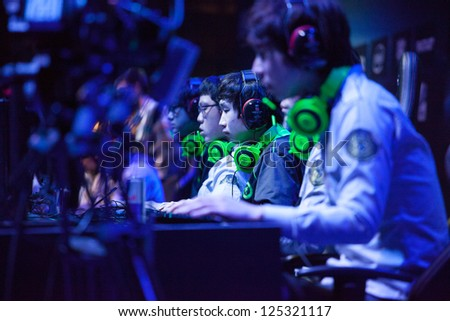 KATOWICE, POLAND - JANUARY 20: Azubu Frost clan (League of Legends players) at Intel Extreme Masters 2013 - Electronic Sports World Cup on January 20, 2013 in Katowice, Silesia, Poland. - stock photo