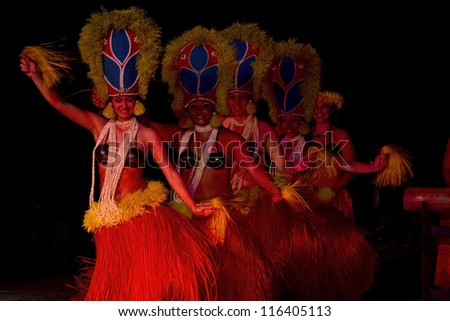 KAUAI, HAWAII - AUGUST 11: Aloha festival. Attractive young women in traditional dress perform Hawaiian dance on August 11, 2012 in Lihue, Kauai. - stock photo