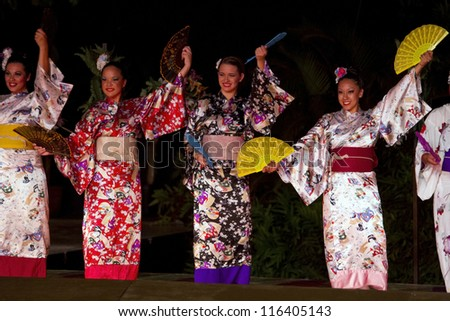 KAUAI, HAWAII - AUGUST 11: Aloha festival. Attractive young women in traditional dress performs Japanese dance on August 11, 2012 in Lihue, Kauai. - stock photo