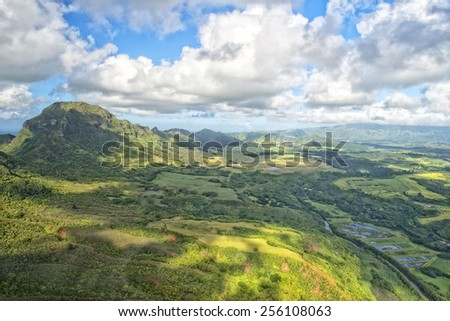 kauai hawaii island mountains and canyon aerial view from helicopter - stock photo