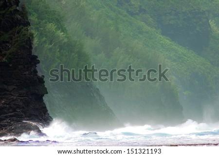 Kauai Hawaii mountainous shoreline crashing waves - stock photo