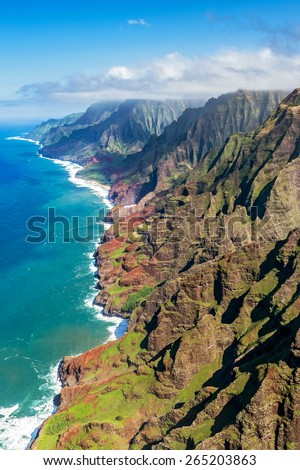 Kauai's rugged Na pali coastline from a doors off helicopter tour - stock photo