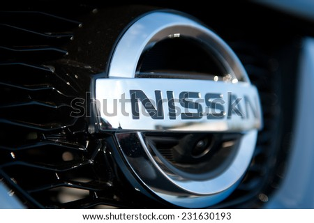 KAUNAS - SEP 19: Close-up of Nissan logo on Sep. 19, 2014 in Kaunas, Lithuania. Nissan Motor Corporation is a Japanese multinational automobile manufacturer headquartered in Nishi-ku, Yokohama, Japan. - stock photo