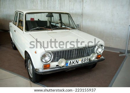KAUNAS-SEP 19: Soviet car VAZ-2101 Zhiguli on display on Sep. 19, 2014 in Kaunas, Lithuania.The VAZ-2101 is a compact sedan car produced by AvtoVAZ and introduced in 1970, the company's first product. - stock photo