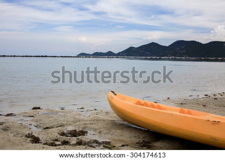 Kayak at the tropical and peaceful beach - stock photo