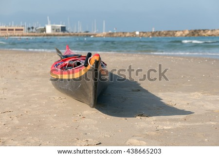 Kayak lies on the shores of the Mediterranean in Israel - stock photo