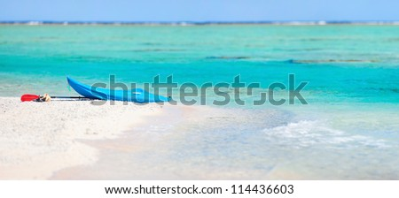 Kayak on an exotic pink sand beach - stock photo