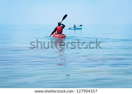 Kayak. People kayaking in the ocean - stock photo
