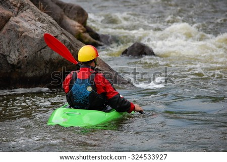 Kayaker is ready to training on a rough water. Southern Bug river, Ukraine. - stock photo
