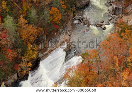 kayakers contemplate going down a rapid viewed from above at Tallulah Gorge, Georgia. - stock photo