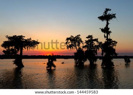 Kayaking at sunset on Lake Martin, Breaux Bridge, Louisiana - stock photo