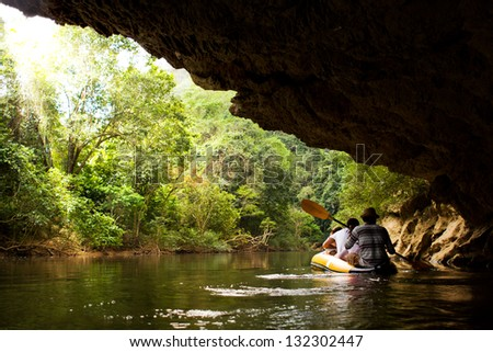 Kayaking from backward view. - stock photo