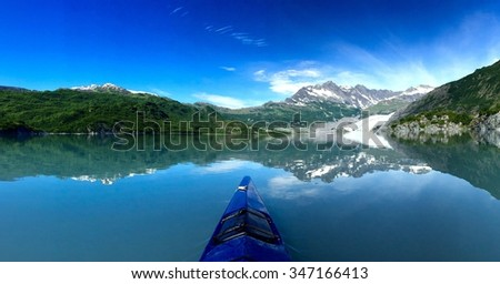 Kayaking in the Shoup Bay near Prince William Sound, Alaska provides some stunning views of the glacier within it./Reflections on the water/Kayaking in the Shoup Bay in Prince William Sound Alaska - stock photo