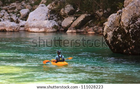 Kayaking in the summer on the Soca river, Slovenia - stock photo