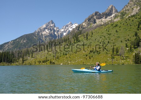 Kayaking on String Lake at Grand Tetons National Park in Wyoming - stock photo