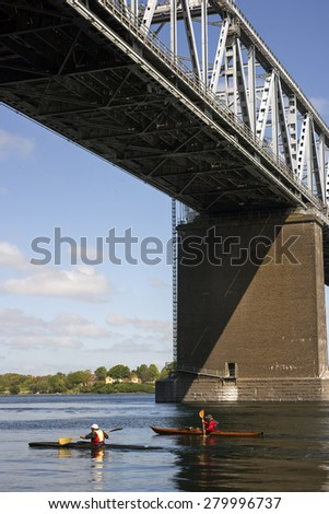 Kayaking under The Old Littlebelt Bridge close to Middelfart in Denmark - stock photo