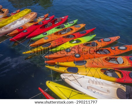Kayaks forming a graceful arch in the waters of Rockport, MA. USA - stock photo
