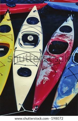 Kayaks in water - stock photo