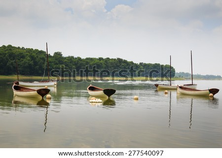 Kayaks on lake resort in Asia - stock photo