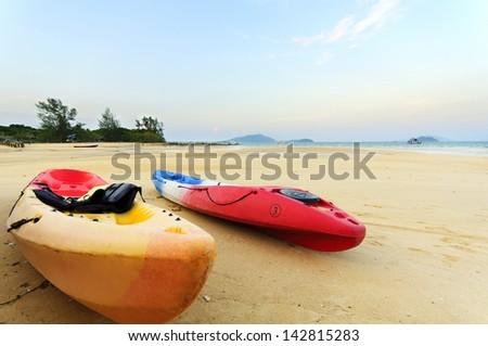 Kayaks on tropical beach - stock photo
