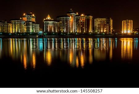 Kazakhstan capital city Astana illuminated at night - stock photo